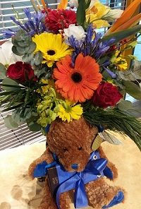 baby girl flowers with teddy